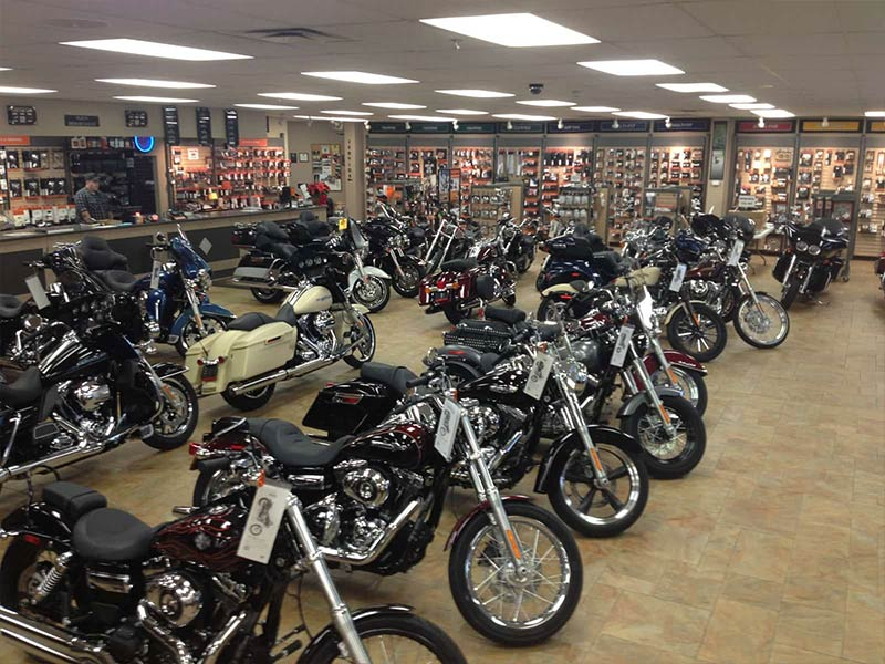 A row of new motorcycles on the showroom floor.